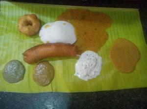 The hot bajji with idli-vada.. served on a fresh banana leaf.